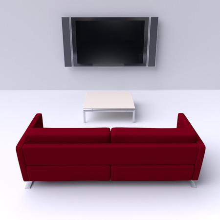 Red sofa with a flat screen TV on the wall photo
