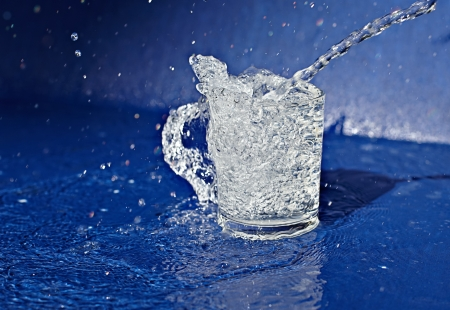 Splashing water from glass forming a handle Stock Photo - 17473401