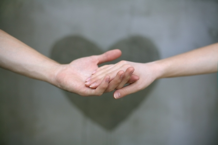 couple holding hands: Man holding woman s hand