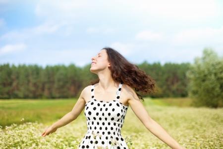 tall woman: Young happy girl walking on the buckwheat field