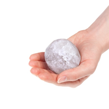 Woman s hand holding a halite salt ball Stock Photo - 17804081