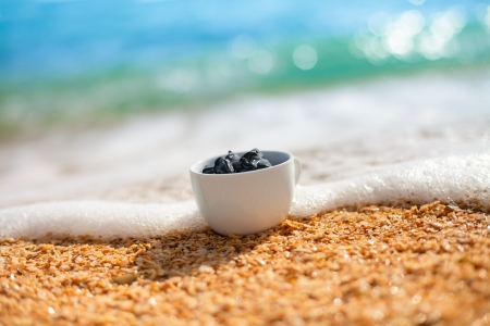 Sea mud in a bowl on the beach Stock Photo - 17804178