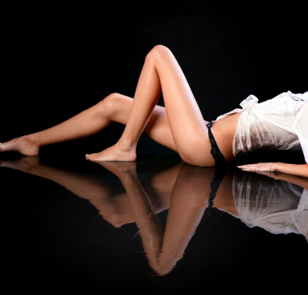 Wet female body with reflection on the floor Stock Photo - 17958778