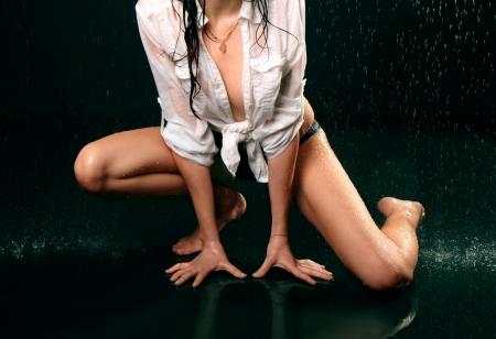 Wet female body on black background Stock Photo - 18016814