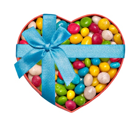hart: Heart-shaped box filled with colorful candies and tied with blue ribbon and bow