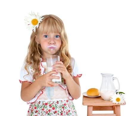 Little girl with milk mustache after drinking milk isolated on white background photo