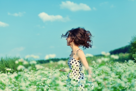 Young happy girl walking on the buckwheat field photo