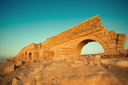 Aqueduct in ancient city Caesarea in Israel photo