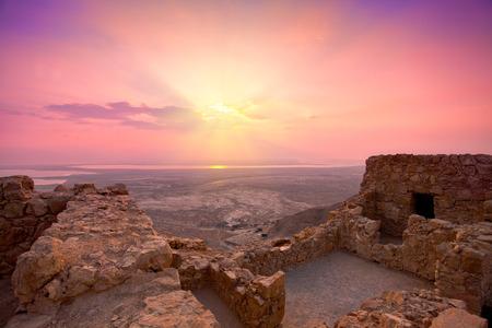 Beautiful sunrise over Masada fortress in Judaean Desert photo