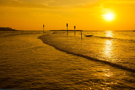 Gold sunset over sea photo