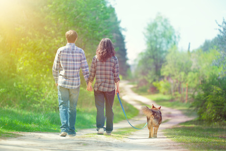 Young couple walking with dog photo