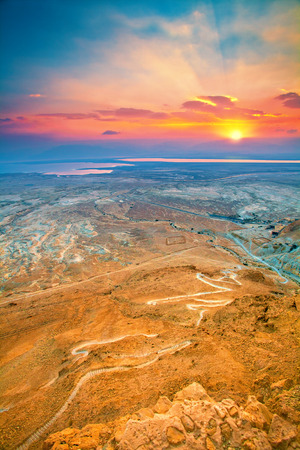 judaean desert: Beautiful sunrise over Masada fortress  Ruins of King Herod s palace in Judaean Desert