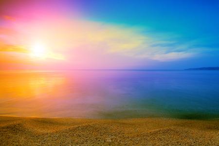 Magical rainbow sunrise over sea photo