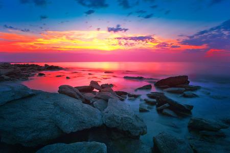 Sunrise over a rocky coast photo