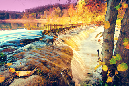 rushy: River with waterfall in autumn