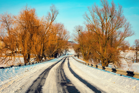 Winter snowy road with trees photo
