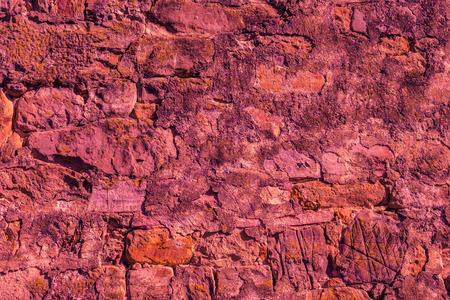 Marsala stone wall texture background photo