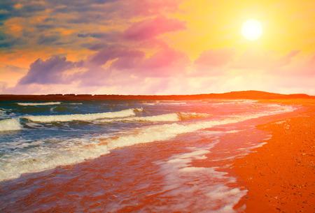 Beautiful deserted beach at sunset photo