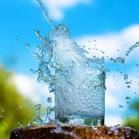 Splashing water from glass photo