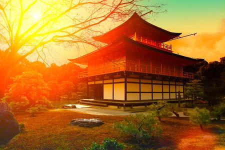 japan sunset: Magic sunset over kinkakuji Temple, Kyoto, Japan