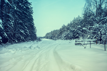 Vintage winter snowy deserted road photo