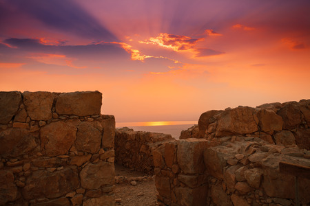 desert sun: Beautiful sunrise over Masada fortress