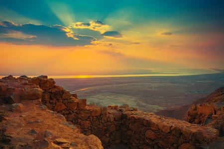 Beautiful sunrise over Masada fortress photo