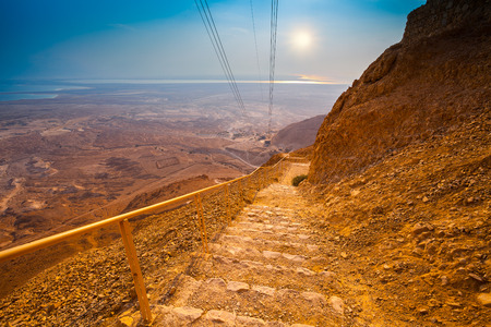 Stairway and cableway to Masada fortress, Israel. Sanrise over Judean desert photo