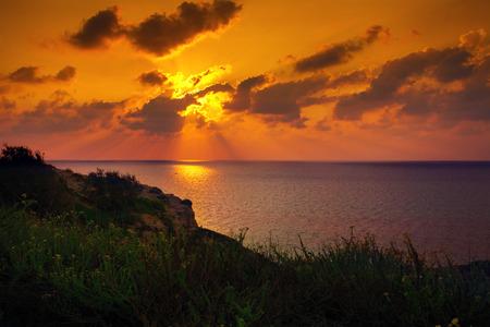 Orange sunset over Mediterranean Sea photo
