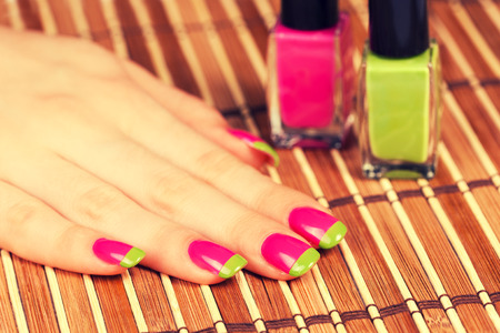 skin color: Beautiful female hand with two-color manicure Stock Photo
