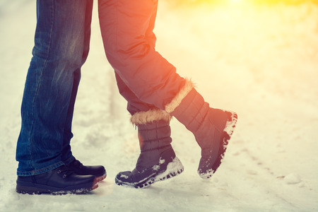 in kiss: Couples in love outdoors in winter