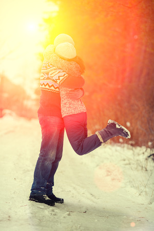 couples outdoors: Hugging couples in love outdoors in winter at sunset light