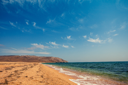 nature reserves of israel: Wild deserted beach with cloudy sky