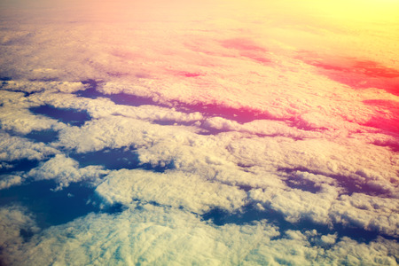 window view: Cloudy sky at sunrise. View from airplane window Stock Photo