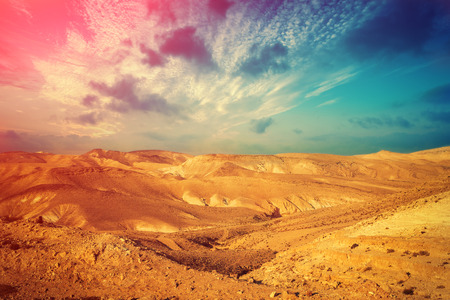 judean hills: Mountainous desert with colorful cloudy sky. Judean desert in Israel at sunset Stock Photo