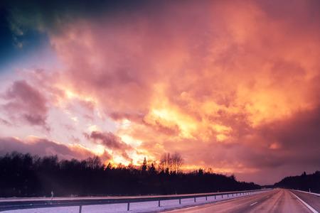 autobahn: Autobahn at sunset with dramatic purple sky