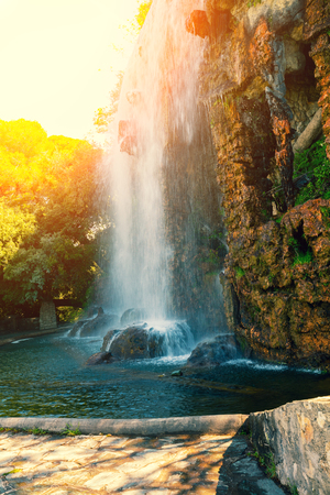 crick: Waterfall in the park at sunrise