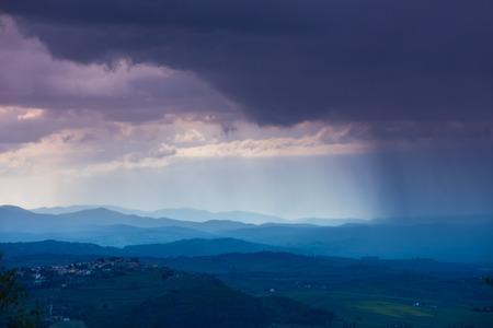 valdorcia: Cloudy rainy sky over mountain valley. Tyscany, Italy Stock Photo