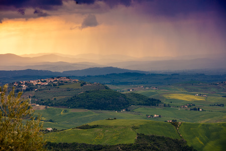 valdorcia: Tuscany valley in stormy weather at sunset, Italy Stock Photo