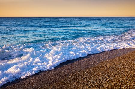azure: Pebbles beach at sunset