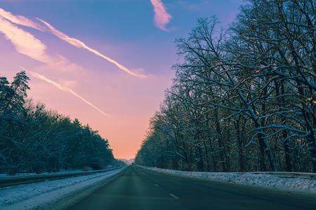 autobahn: Autobahn in winter at purple sunset