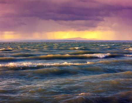 balaton: Stormy rainy weather at sunset on the sea.  Balaton lake, Hungary