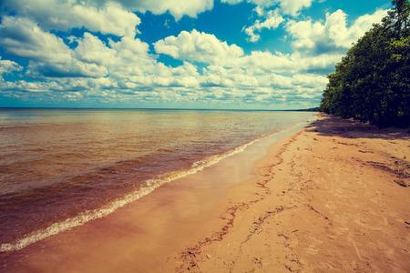 eventide: Baltic sea coast. Deserted wild beach Stock Photo