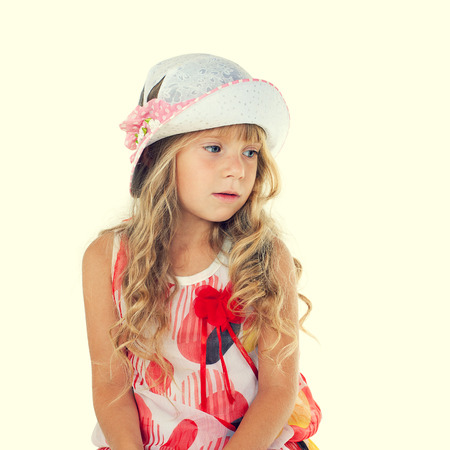 Fashion portrait of thoughtful little girl with hat photo