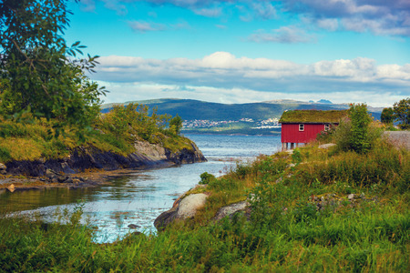rorbu: fjord with typical wooden rorbu or fishermans houses in Norway