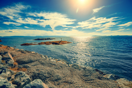 Rocky sea coast. Fjord with blue sky. Stock Photo