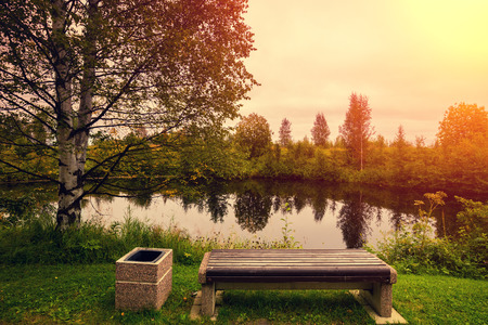 fog forest: Rural landscape in the morning. Lake with reflection at sunset light. Bench on the bank near lake. Stock Photo