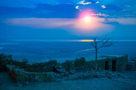 judaean: Beautiful sunrise over Masada fortress. Ruins of King Herods palace in Judaean Desert. Stock Photo