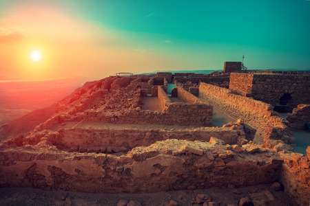 Beautiful sunrise over Masada fortress. Ruins of King Herod's palace in Judaean Desert. Banco de Imagens