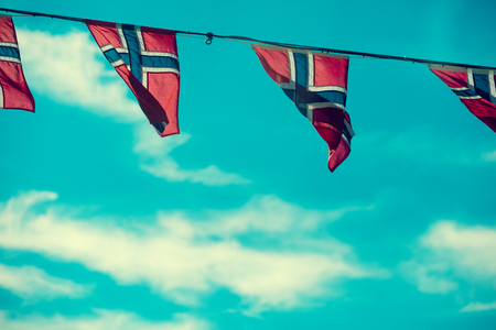 norway flag: Norwegian flags against blue sky. Stock Photo